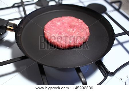 Crude Cutlet Of Fresh Meat, Preparation For The Burger On An Old Vintage Pan. Food And Cooking. Sele