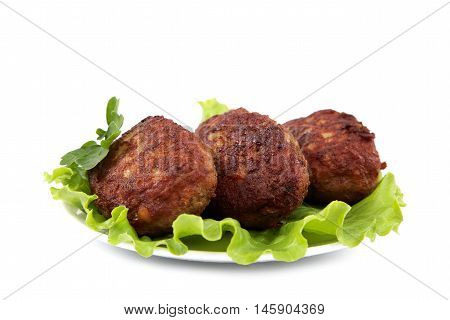 Meat patties with fresh lettuce isolated on a white background.