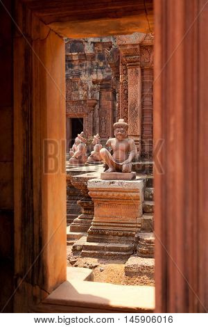 Banteay Srei - 10th century Cambodian temple. Statues seen through a window.