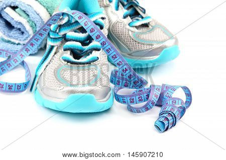 Sports Shoes measuring tape towel isolated on white background. Fitness concept.