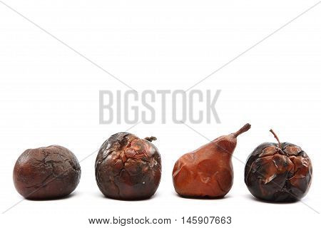 Rotten apples and pear isolated on white background.
