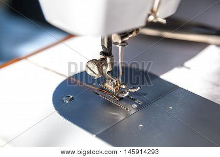 Sewing machine and a fabric close up.