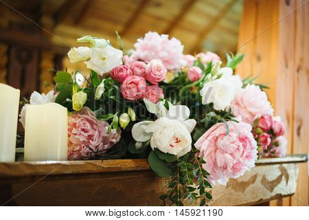 Wedding table decoration with pink peonies and carnations, roses