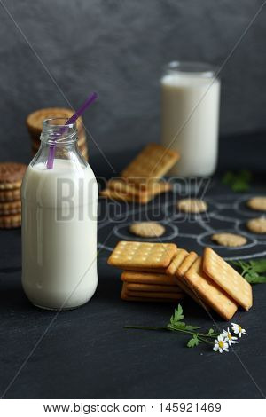 Salted Crackers And Bottle Of Milk On Board