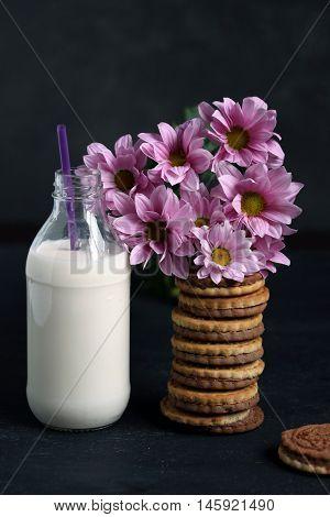 Sweet Cookies, Bottle Of Milk And Pink Flowers For Breakfast