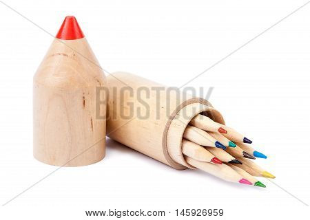 Colored pencils in a stylish wooden pencil case isolated on white background.