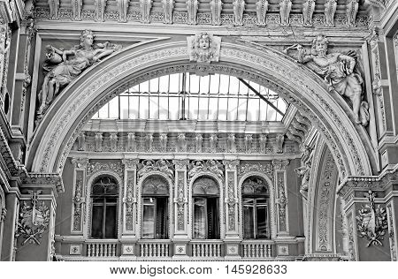 Sculptures of modernist style on the balcony of Odessa passage - old covered mall and architectural monument, Odesa, Ukraine. Black and white
