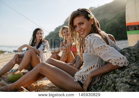 Happy Young Woman Relaxing On The Beach With Friends