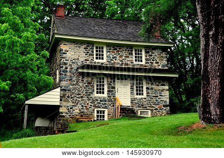 Chadds Ford Pennsylvania - June 2 2015: The historic 1725 fieldstone John Chads' House with its exterior beehive oven remains essentially in its original condition