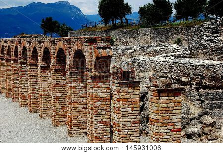 Sirmione Italy - June 1 2006: Ruins of the Roman villa which belonged to the poet Catullus at the Grottoes of Catallus overlooking Lake Garda