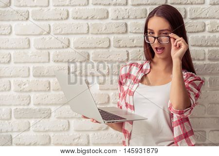 Attractive Young Girl With Gadget