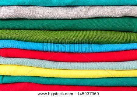 Clothes in the stack as a background.