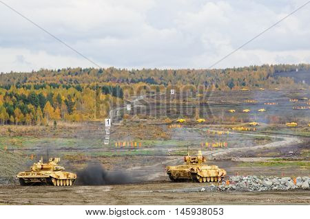 Nizhniy Tagil, Russia - September 26. 2013: T90S and Tank Support Fighting Vehicle BMPT-72. Display of fighting opportunities of arms and military equipment of land forces. RAE-2013 exhibition
