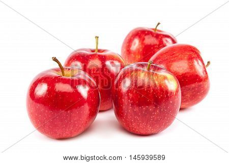 Fresh red apples isolated on white background.
