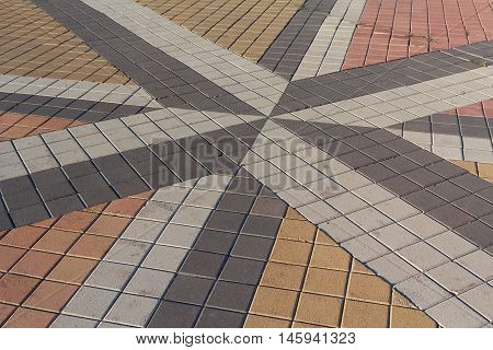 Pattern of inlaid colored paving slabs. Backgrounds and textures