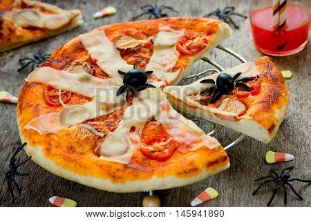 Halloween spider pizza recipe. Halloween fun food idea selective focus