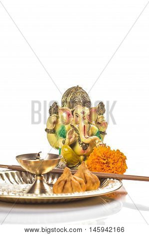 Hindu God Ganesha. Statue of Lord Ganesha. Pooja arrangement on white background.