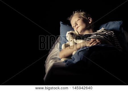 Cute Boy Sleeping In Bed With Plush Toy Bear