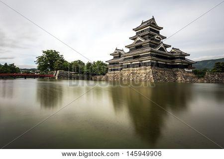 Matsumoto Castle with water blur in Matsumoto, Japan