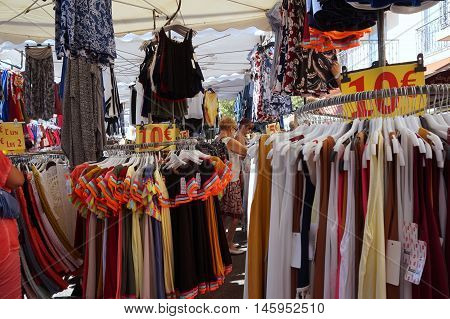 St Aygulf, Var, Provence, France, August 26 2016: Provencal Market Stall Selling Clothes And Other I