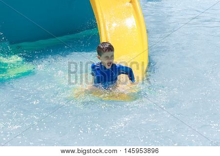 Boy Having Fun In Pool Water Park