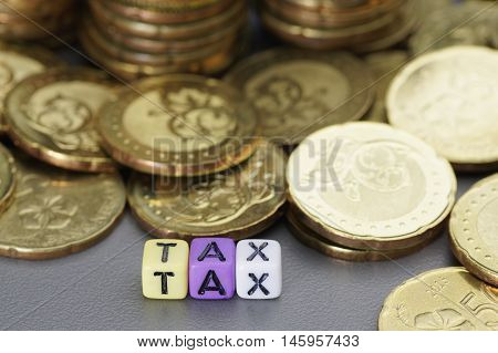 Close up Tax word written on colorful dices