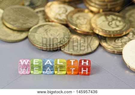 Wealth word written on colourful dice - Finance concept