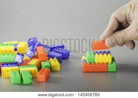 Brick Toys And Hand