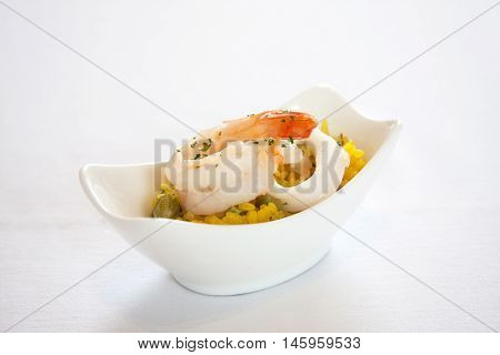 Rice blew seafood isolated in a white cup.