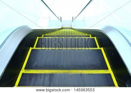 Look down escalator from the top floor in superstore