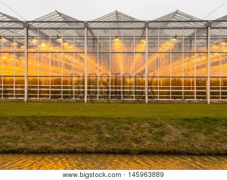 Abstract background of a commercial glasshouse with light
