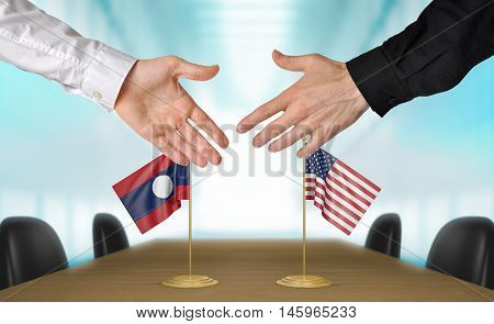 Laos and United States diplomats shaking hands to agree deal, part 3D rendering