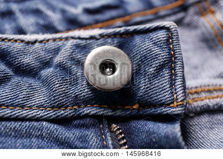 Button on a denim cloth close up