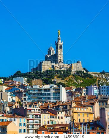 Marseilles in May. The Old Port and on the hill - splendid Basilica of Notre-Dame de la Garde