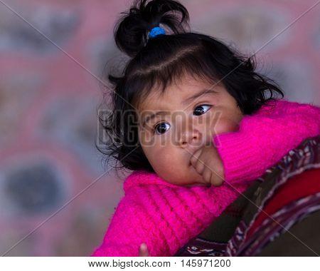 Portrait Of A Curious Native Peruvian Baby
