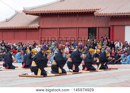 Okinawa, Japan - January 02, 2015: Dressed people at the traditional New Year celebration at Shuri-jo castle.