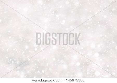 Christmas Texture With Snowflakes. White And Pink Colored Background. Card For Seasons Greetings. Magic Bokeh Effect With Lights. Copy Space For Advertisement.