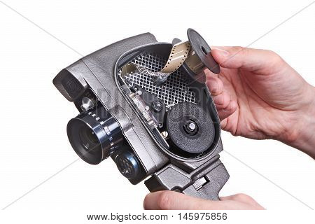 Retro Mechanical Movie Camera With Film In Hands Isolated
