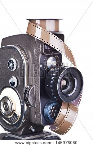 Retro Mechanical Movie Camera And Film Isolated