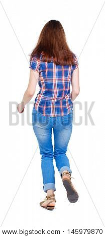back view of running woman. beautiful girl in motion. .Girl in plaid shirt runs off into the distance.