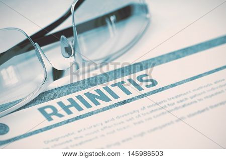 Rhinitis - Medicine Concept with Blurred Text and Pair of Spectacles on Blue Background. Selective Focus. 3D Rendering.