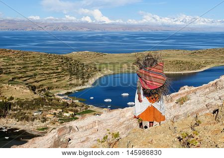 Bolivia - Isla del Sol on the Titicaca lake the largest highaltitude lake in the world (3808m) This island's legendary Inca creation site and the birthplace of the sun. Native women return to the village