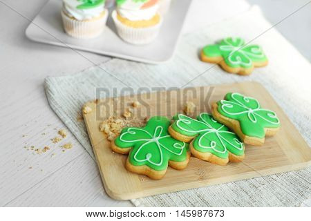 Decorative cookies on cutting board. Saint Patrics Day concept