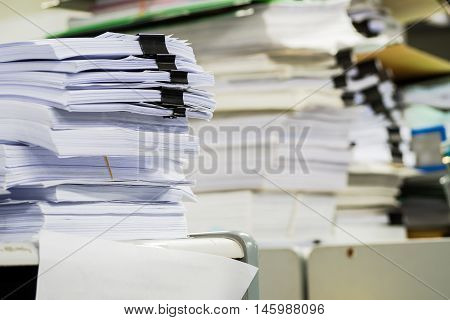 Piles of paper in the office in working time