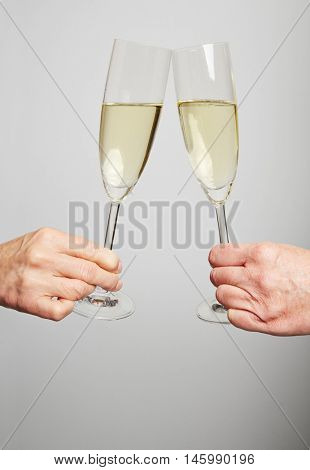Drinking champagne in a glass for celebration at New Year's Eve