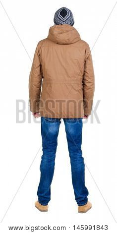 Back view of handsome man in winter jacket  looking up.   Standing young guy in parka. Rear view people collection.  backside view of person.  Isolated over white background.