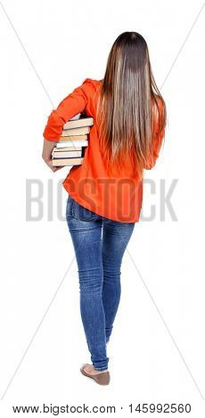 Girl comes with stack of books. back side view. student in red jacket goes away with a lot of books under his arm.