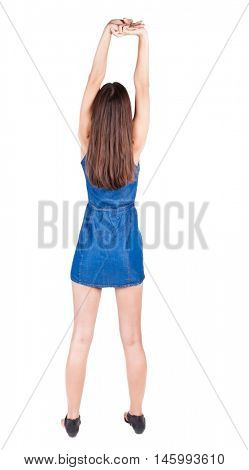 back view of young woman limber up.  brunette girl in red dress and  kitten heels watching. Rear view people collection.  backside view of person.  Isolated over white background.