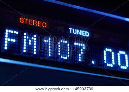 FM tuner radio display. Stereo digital frequency station tuned. Horizontal