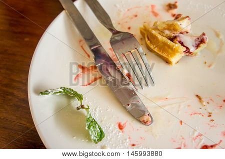 Food on a plate and knives and drills